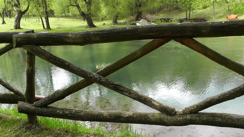 Old Wooden Fence and Pond handheld Footage
