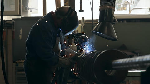 Welder welding a steel spiral Footage