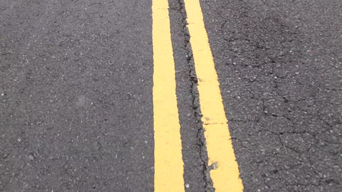 moving yellow lines on the road Footage