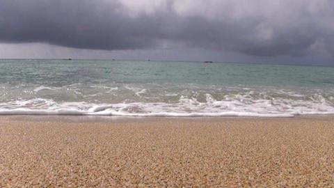 whitecaps landing on sandy beach Footage