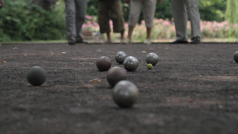 elderly people enjoying boule in a park, ball shoo Live Action