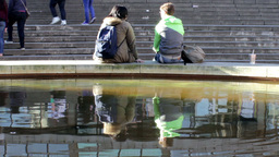 Lonely couple sitting on the edge of fountain Footage