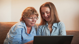 Young Girl And Old Person Learn Laptop stock footage