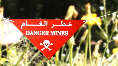 warning sign in front of a minefield Stock Video Footage