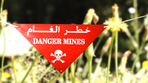 warning sign in front of a minefield Footage