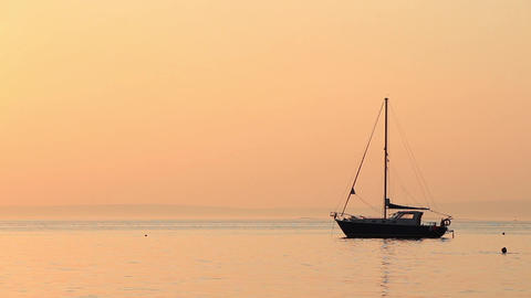 Sailing Boat Under A Peach Sunset Sky 1 stock footage