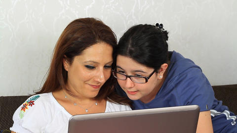 Daughter showing mother how to use a computer Footage