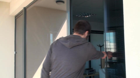 Young Man Enters An Office Building After A Smokin Footage