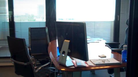 Inside Office Building Managers Office, Tilt Shot Footage