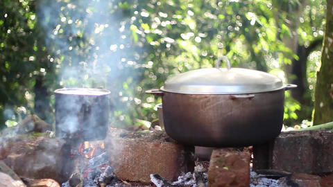 Cooking Over Fire stock footage