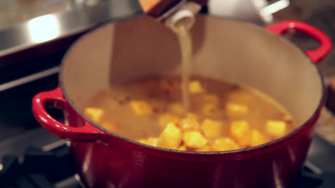 Cooking stock into soup Footage
