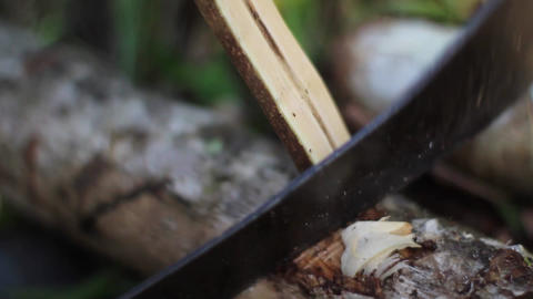 Shaving Wood With Machete Tight Shot stock footage