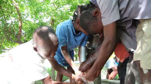 Washing hands at well Live Action