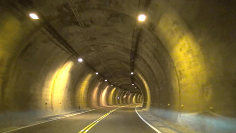 Driving fast through the tunnel.time lapse Footage