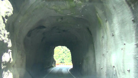driving through tunnel of rock Footage