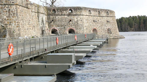 Pontoon bridge leading to the castle Live Action