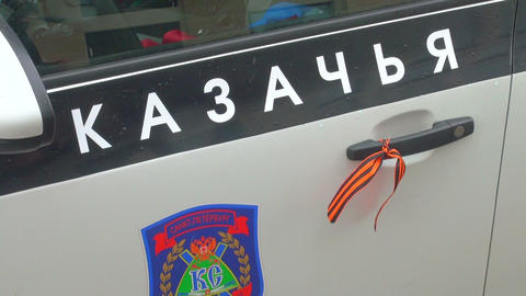 The St. George ribbon on the handle of the car Footage