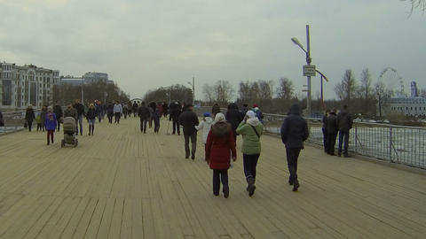 The crowd goes the wooden bridge. timelapse Footage