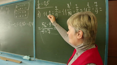 Mathematics teacher in the class at the Board Footage