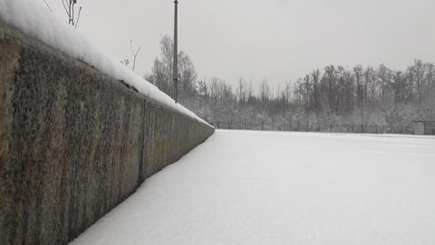 The snow on the asphalt to the curb Footage