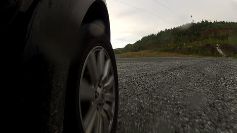The wheel of the machine rolls on gravel Footage