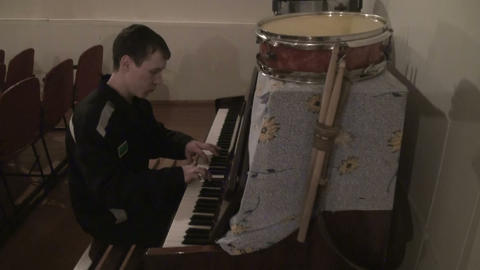A convict in prison plays piano Footage