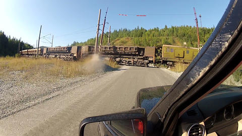 A freight train on a railway crossing Footage