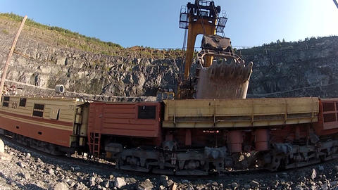 The train cars loaded with ore in the quarry Footage
