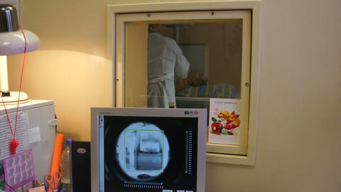 The doctor enables and configures the x-ray machin Footage