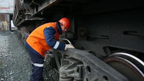 A worker inspects railroad train Footage