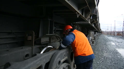 A worker inspects railroad train Footage
