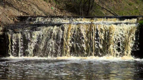 Waterfall in rocky shore Footage