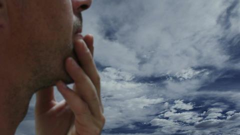Concerned Man Against Timelapse Clouds Close Up Footage