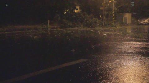 Typhoon blowing debris around on road Footage