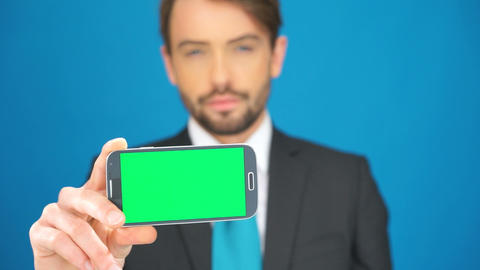 businessman with his smartphone showing the app Footage