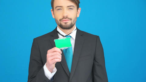 businessman showing his id on blue Footage