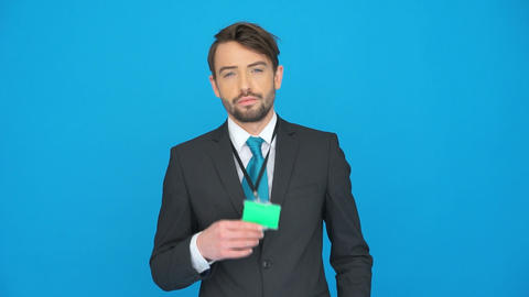 handsome businessman showing his id card Footage
