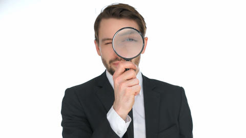 Businessman looking through a magnifying glass Footage