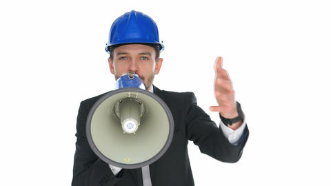 Man wearing a hardhat speaking into a megaphone Footage