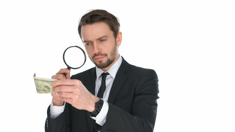 Businessman examining a banknote Live Action