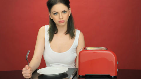 Hungry woman with an empty dinner plate Footage