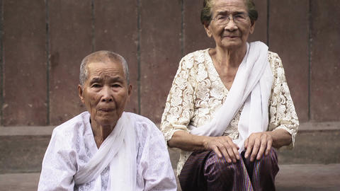 Portrait of real Asian people with emotions and feelings. Old Cambodian women lo Footage