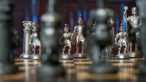 chess figures dolly DOV blue background 11354 Footage