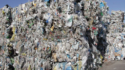 Stack of recycled plastic bags at recycling plant Live Action