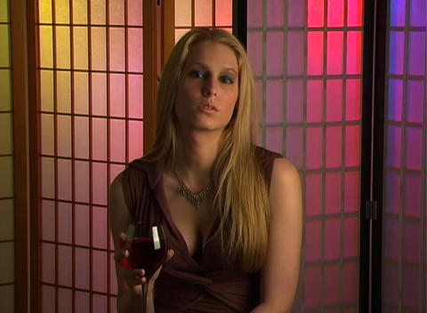 Beautiful Blonde with a Glass of Wine (1) Stock Video Footage