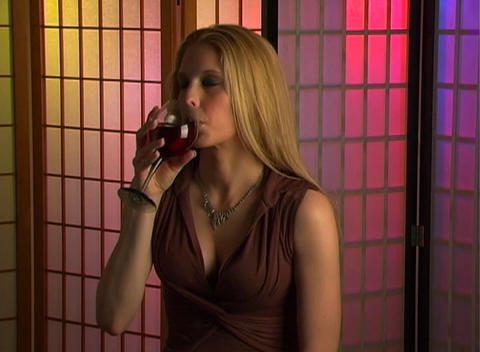 Beautiful Blonde with a Glass of Wine (3) Stock Video Footage