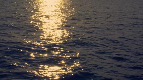 realtime sundown reflection wide ocean Stock Video Footage