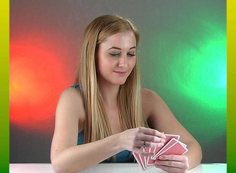 Beautiful Teenage Blonde with Playing Cards Stock Video Footage