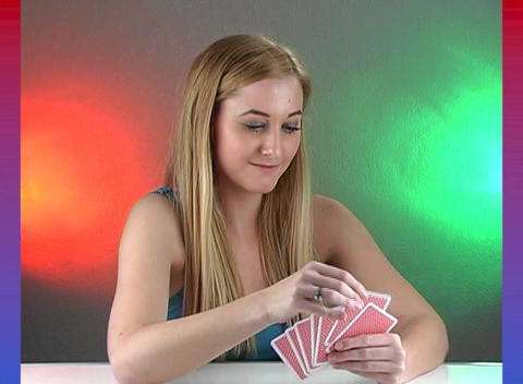 Beautiful Teenage Blonde with Playing Cards Footage
