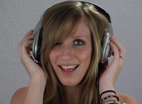 Beautiful Teenage Blonde with Headphones (2) Stock Video Footage